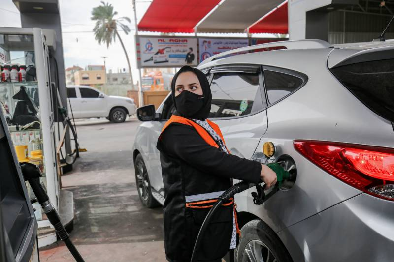 Gaza's first female gas station attendant challenges 'traditions'