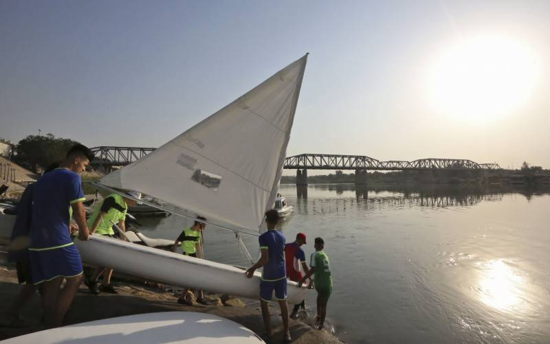 Sailing Baghdad's river bends, young Iraqis rock the boat