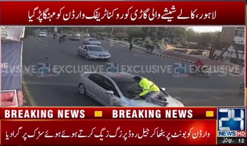 Traffic warden risks life in the line of duty