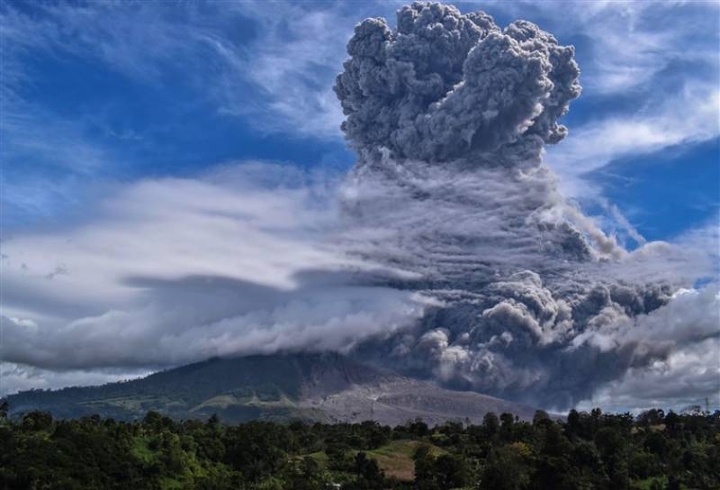 Indonesian volcano belches huge tower of smoke and ash