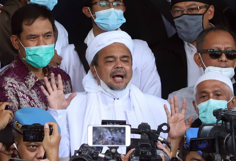 Indonesia arrests religious cleric over virus rule breaches