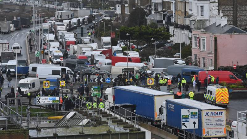 Britain, France ease transport ban as virus variant threatens supply chains