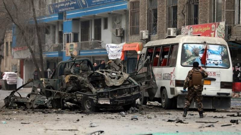 Two Afghan police killed as Kabul hit by bomb blasts