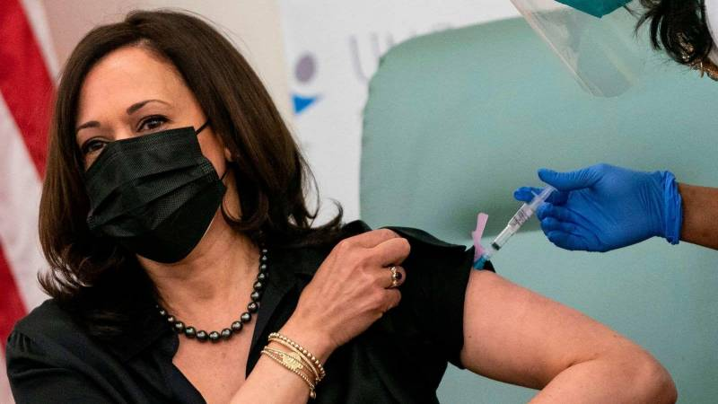Harris vaccinated on camera, urges public to trust process