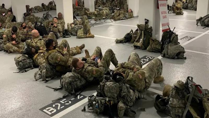 Outrage after troops protecting US Capitol forced to sleep in parking garage