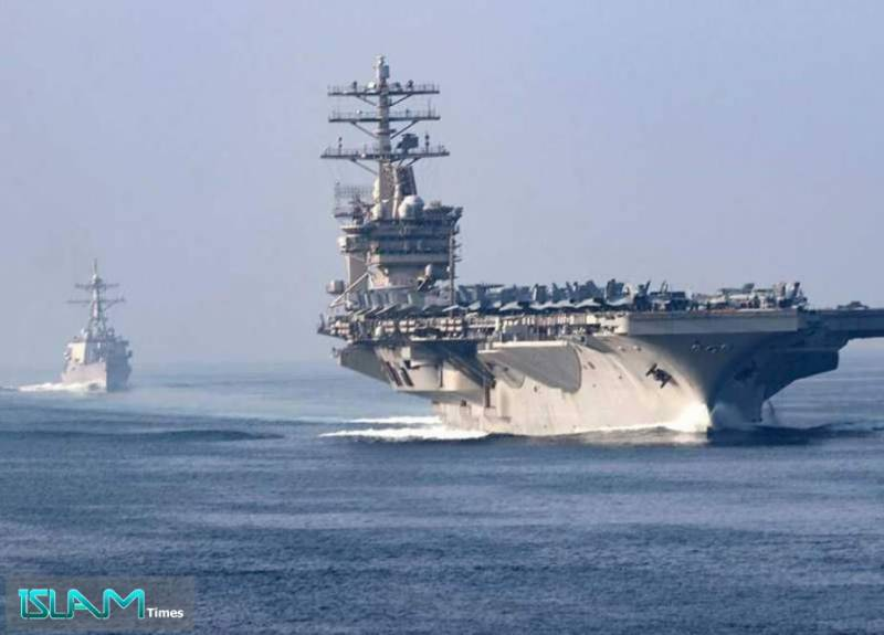 US moves carrier from Gulf in a sign of ebbing tensions