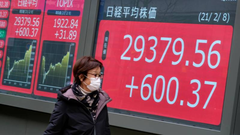 Asian markets track Wall St records on stimulus optimism
