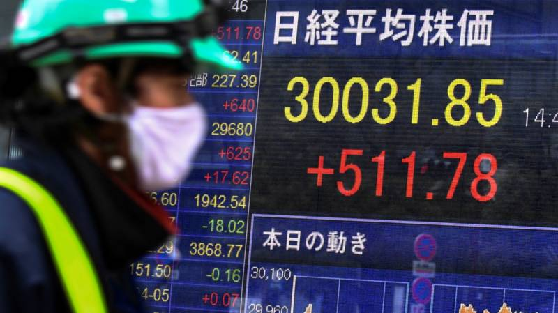 Asian markets slip as inflation fears trump recovery hopes