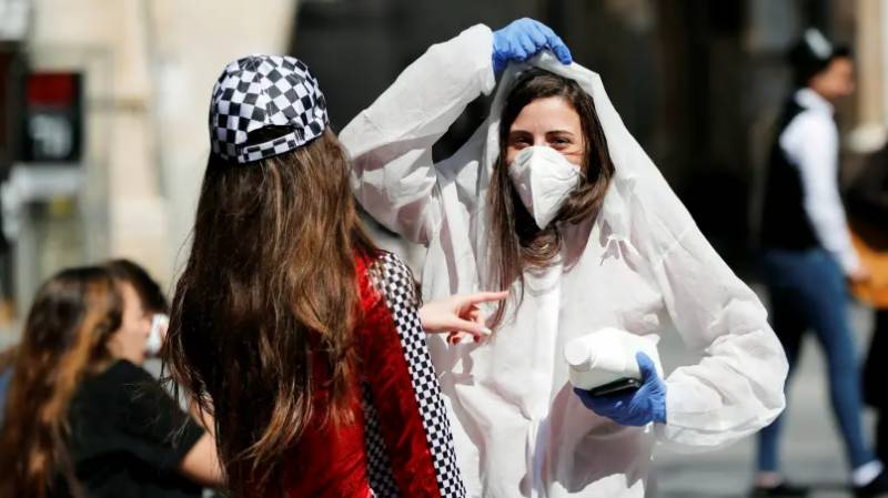 Israel announces curfew over Purim holiday