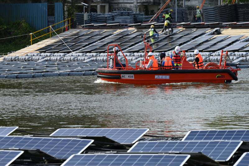 Space-starved Singapore builds floating solar farms in climate fight