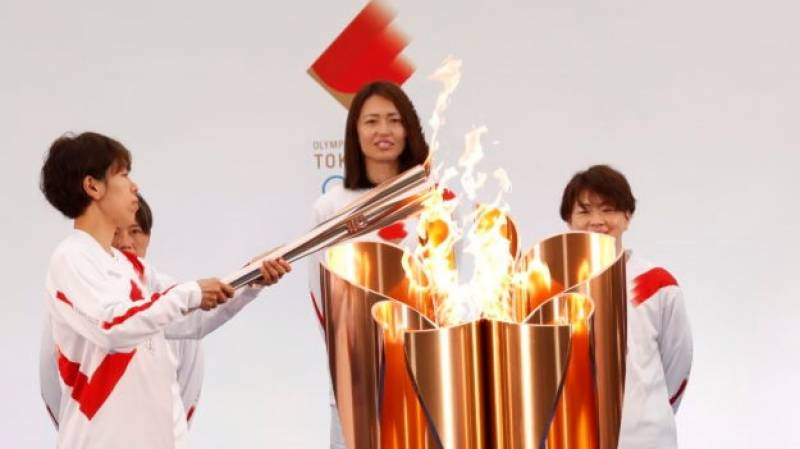 'Ray of light': Olympic torch relay begins after year's delay
