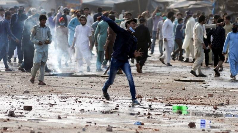 Two policemen among 7 killed in violent protests led by religious group