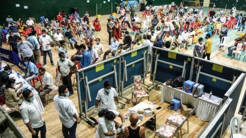 India hospitals overwhelmed by virus as Japan to declare emergency