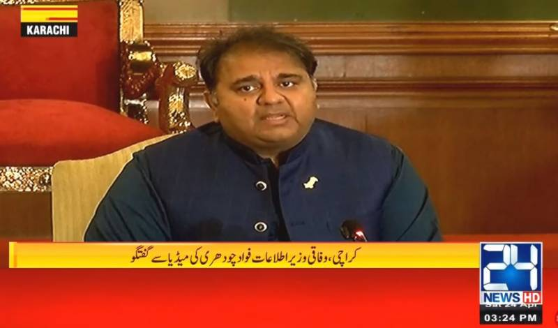 Fawad Chaudhry addresses a news conference in Karachi.