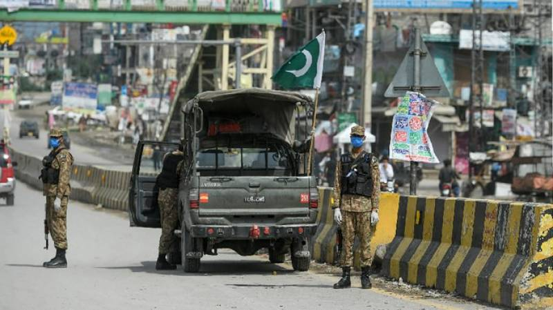 Troops of Pakistan Army join police in efforts to enforce Covid-19 SOPs