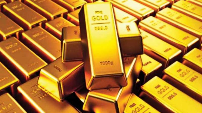 Gold price down by Rs700 per tola in Pakistan