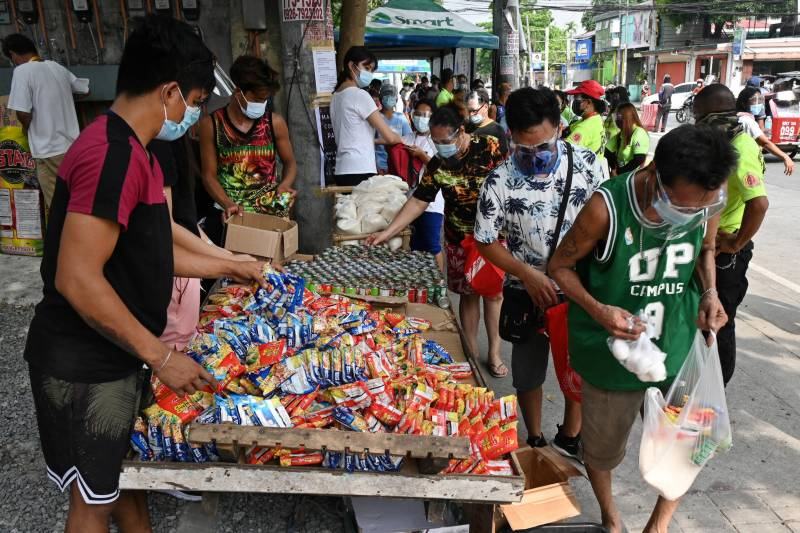 Food pantries spread in Philippines as virus restrictions bite