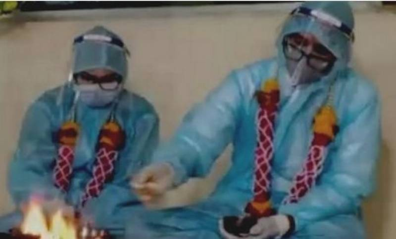 Indian couple gets married in PPE kits after groom tests corona positive