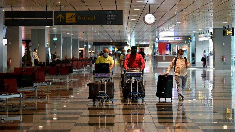 UK eases foreign travel curbs