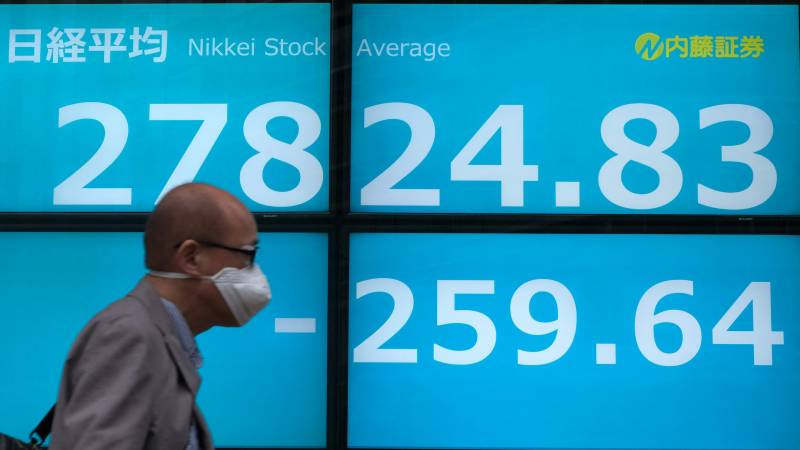 Asian markets mixed as traders weigh recovery and new infections