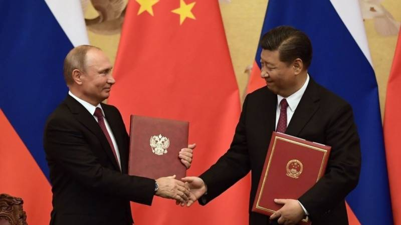 Putin, Xi hail ties at launch of work on nuclear plants in China