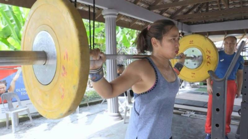 Far from home: Weightlifter's quest for first Philippines Olympic gold