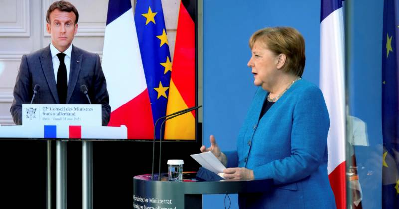Macron, Merkel want explanations from US, Denmark over spying report