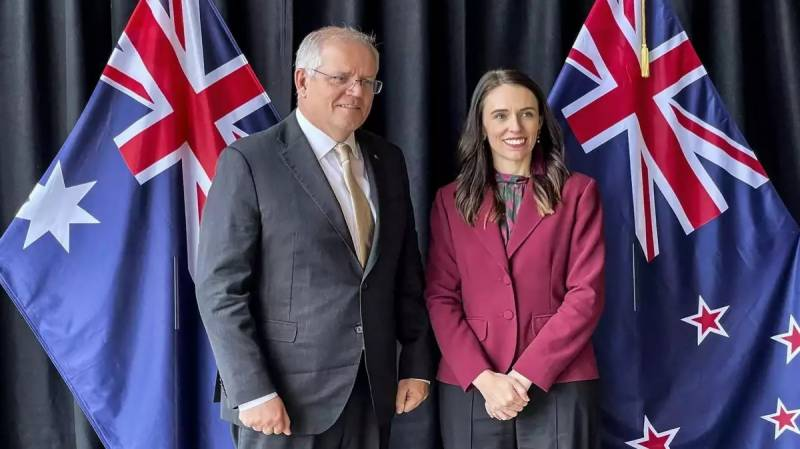 New Zealand, Australia play down differences on China