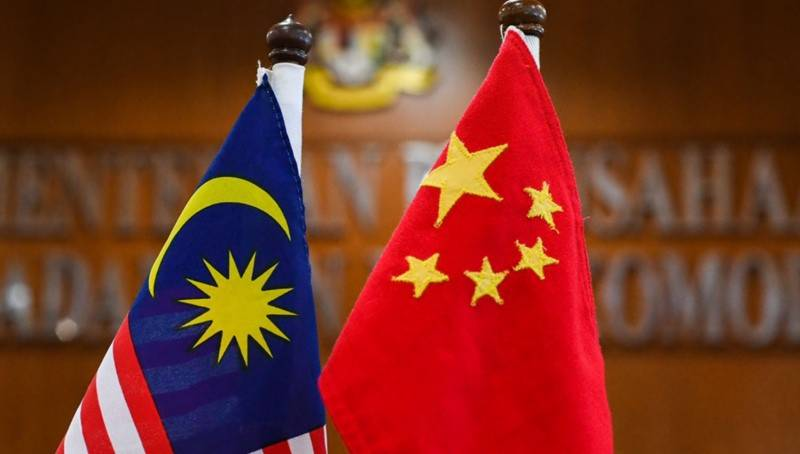 China says military flight off Malaysia was 'routine training'