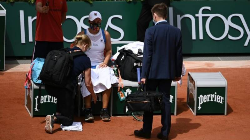Barty limps out of French Open as Nadal set for lonely 35th birthday