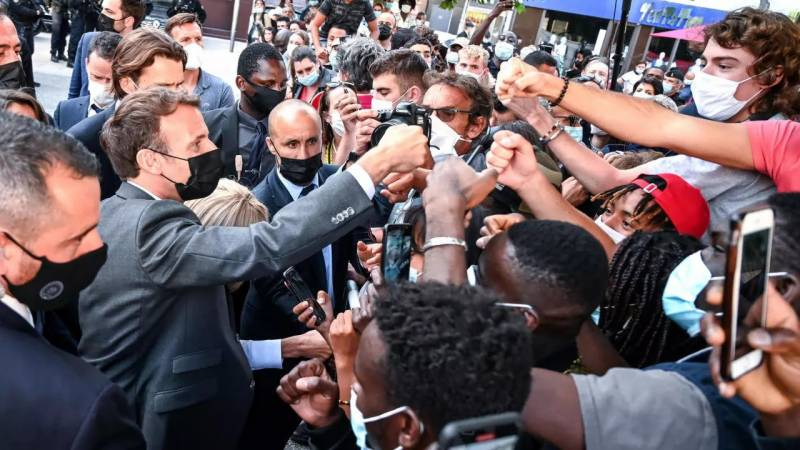 Macron vows to defy security fears after slap
