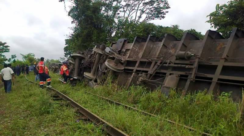 One dead as freight train topples onto Mexican homes