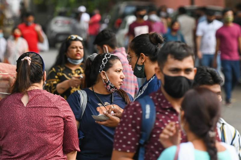 Indians throng malls and markets weeks after Covid surge