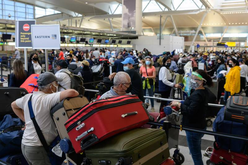 Sudden travel surge tests US airlines