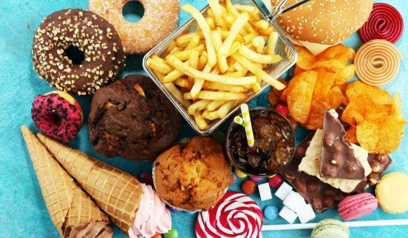 UK to limit junk food ads to tackle child obesity