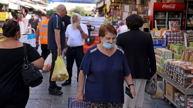 Israel resumes indoor mask requirement amid virus spike