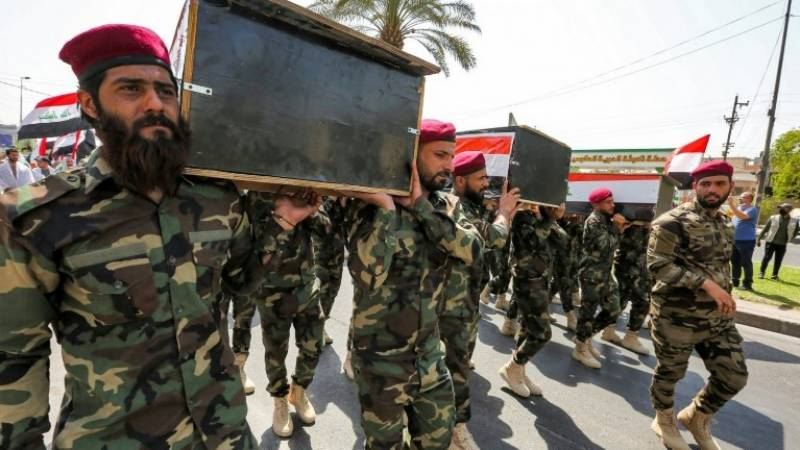 Iraqi fighters mourn comrades killed in US strikes
