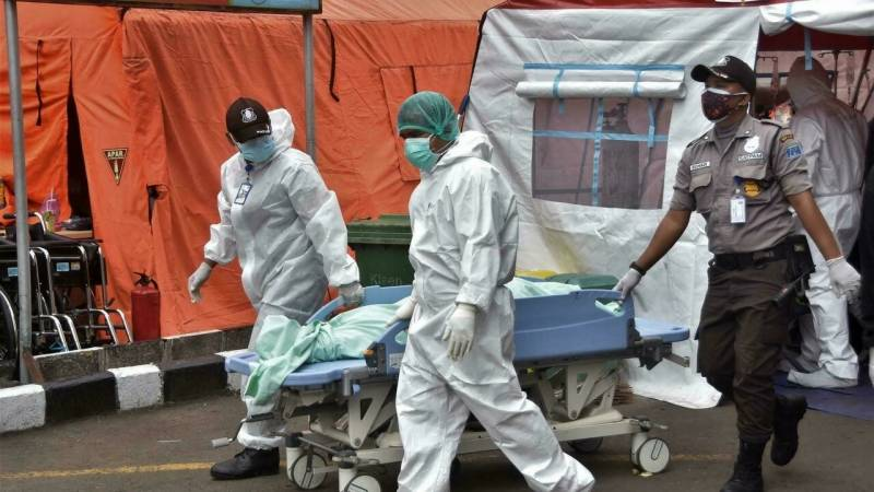 Indonesia to impose emergency curbs to battle virus surge