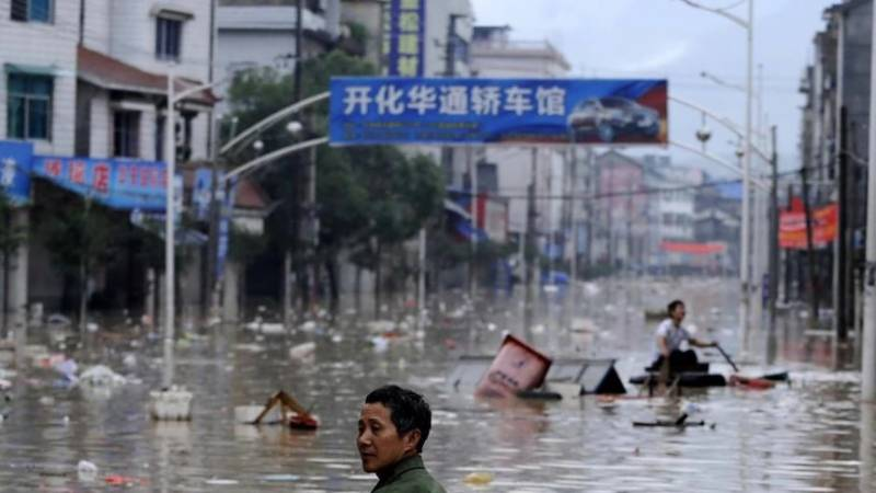 Chinese city battered by storms as subway floods