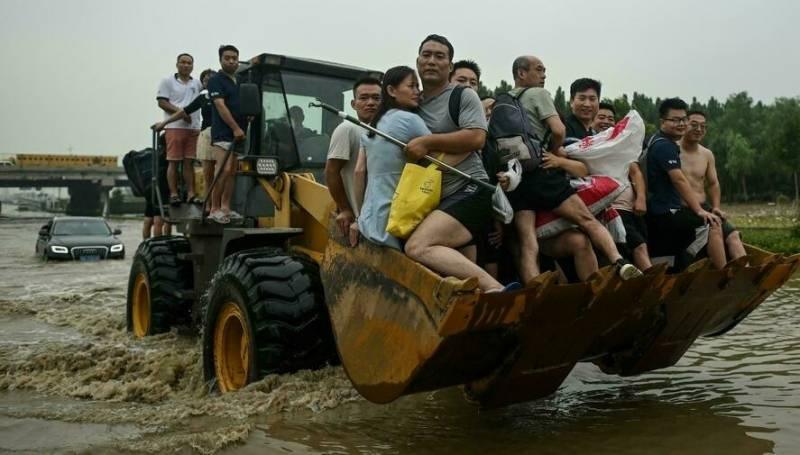 Villagers flee fresh floods in central China as typhoon approaches
