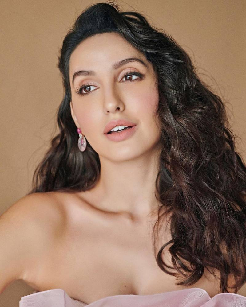 Nora Fatehi too hot to handle in new pics and dance video