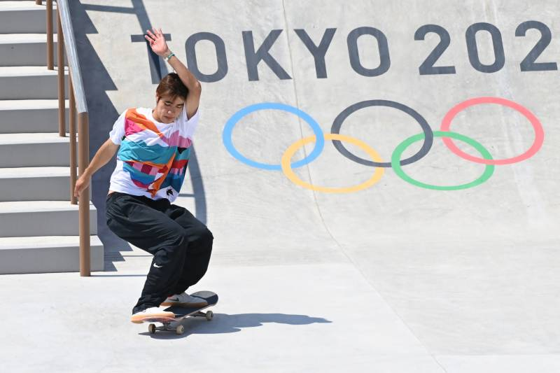 Japan celebrates gold rush on day of upsets at Olympics