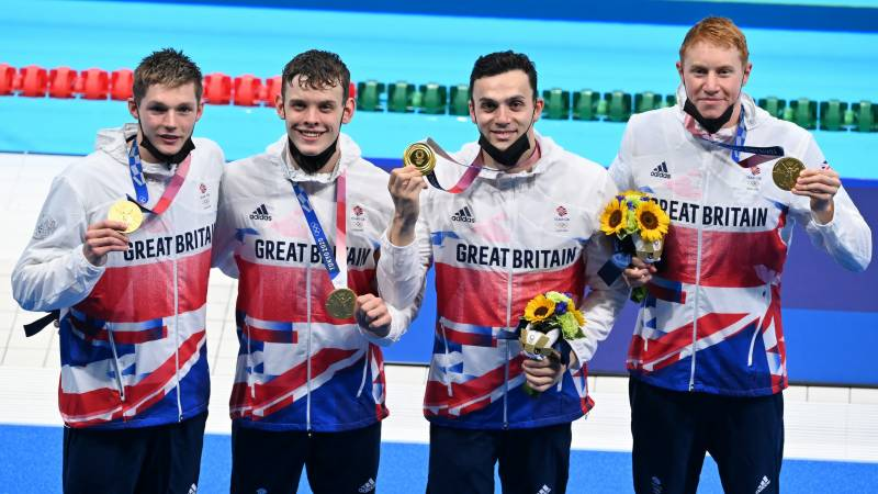 Britain win gold in swimming relay, just miss world record
