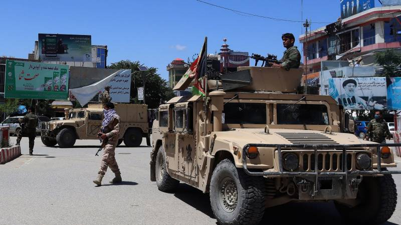 Taliban warn of more targeted attacks as Afghan forces defend besieged cities