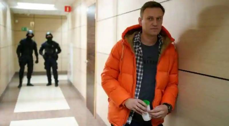 Navalny risks more jail time after new charge