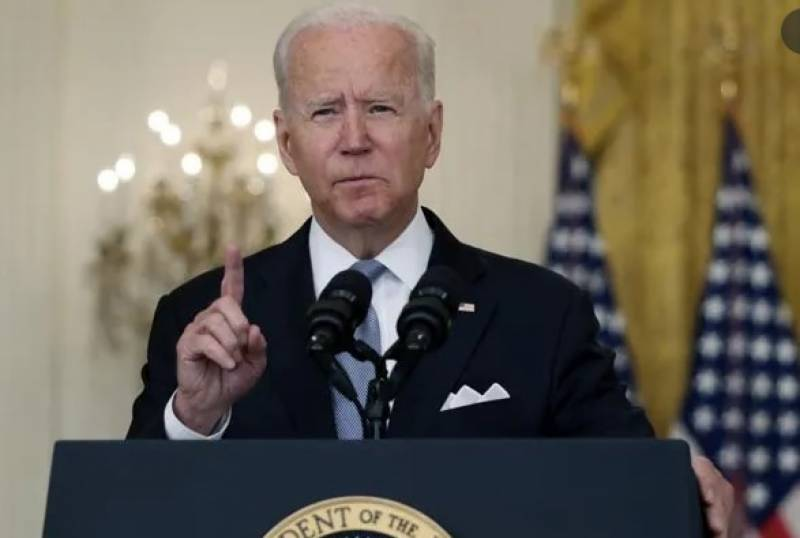 Biden warns may act against governors opposing school mask mandates