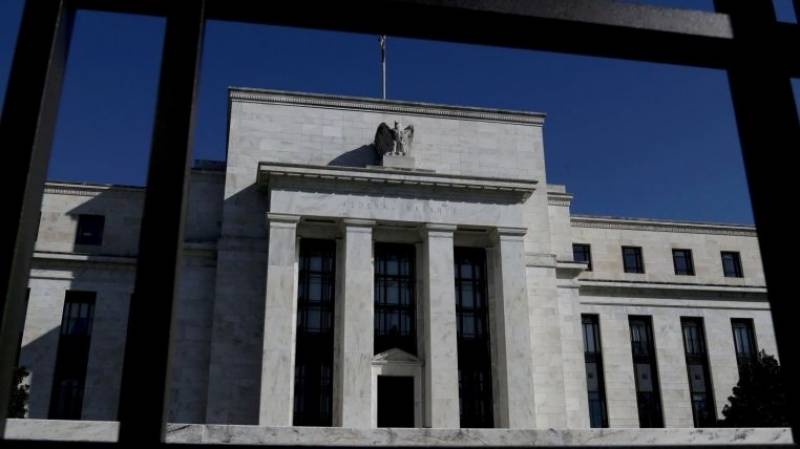 US Fed officials expect to pull back on stimulus this year