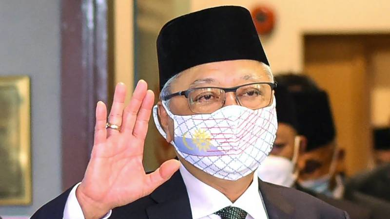 Malaysian PM misses cabinet swearing-in after Covid contact
