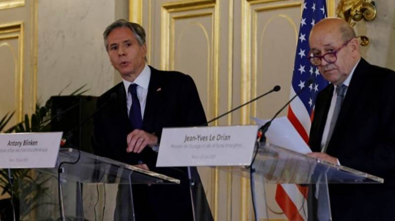 Way out of crisis will take 'time' and 'action', France tells US
