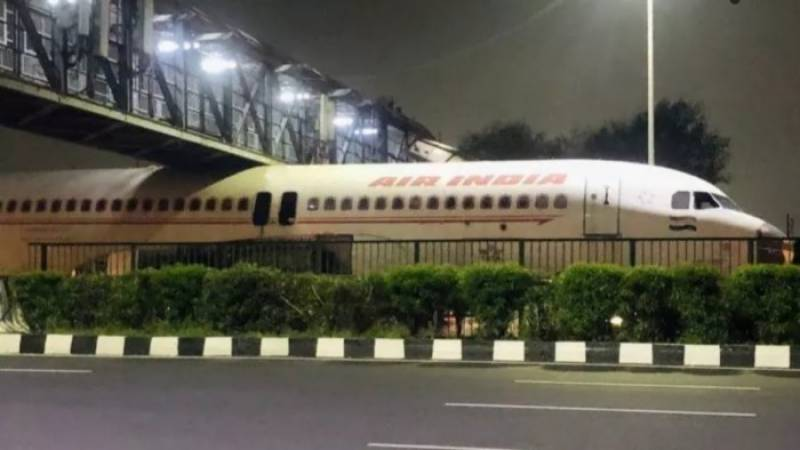 In a bizarre incident, an Air India plane stuck under a foot overbridge in New Delhi.